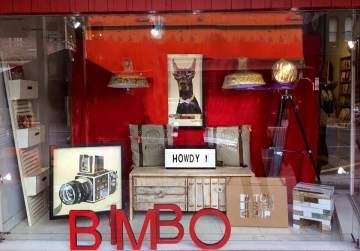 Bimbo window display being friendly and featuring the howdy signs and collage prints